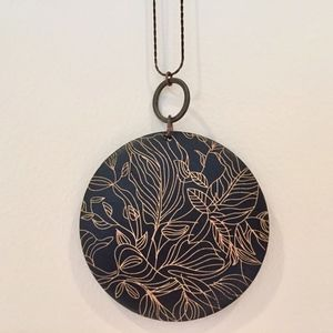 Carved wood circle abstract foliage necklace